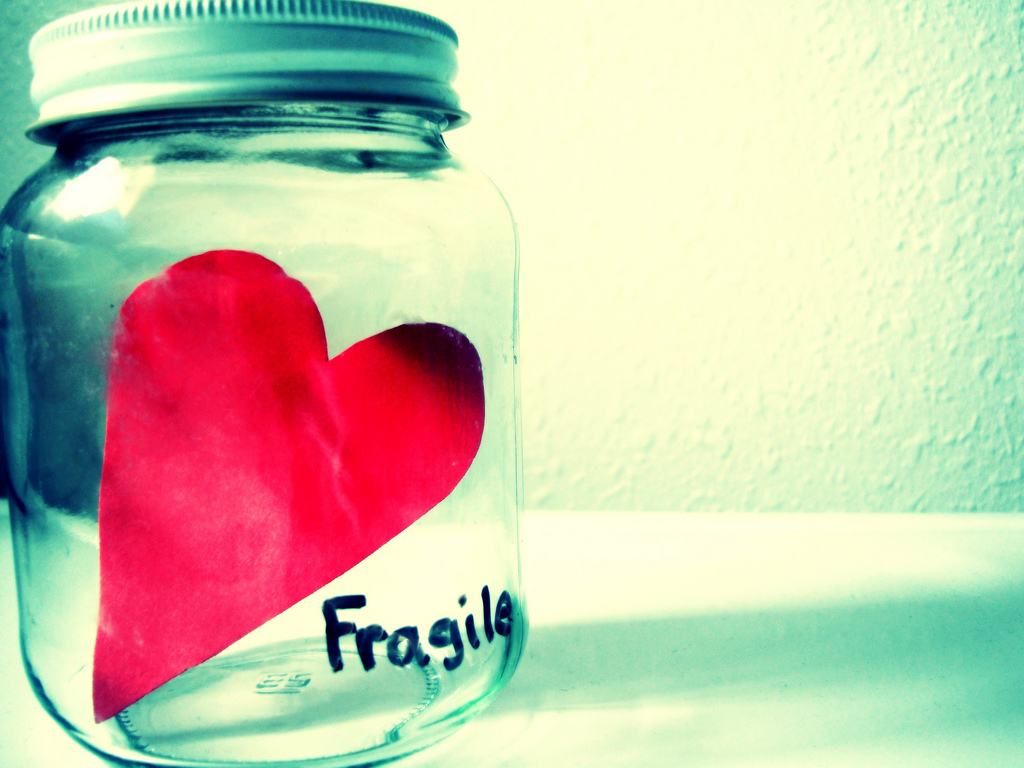 Fragile heart in jar