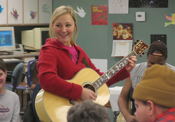 music therapist with guitar